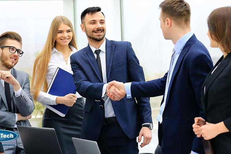 Professional business people shaking hands after a meeting